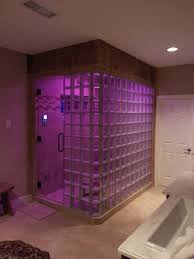 spa bathroom showers: spa bathroom shower ideas photo  shower with transparent tiles and purple lights