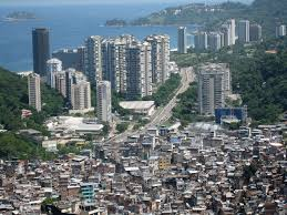 slum   wikipediaa slum in brazil  rocinha favela is next to skyscrapers and wealthier parts of the city  a location that provides jobs and easy commute to those who live in