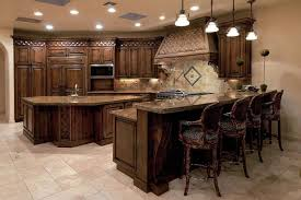 cabinets kitchen breakast bar traditional kitchen with dark wood cabinets and granite breakfast bar