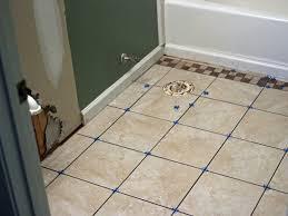 ceramic tile for bathroom floors: step  original mick telkamp install bathroom tilejpgrendhgtvcom