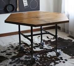 secure the legs and wheels black iron pipe table