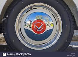 the reflection in the wheel hub of a vintage volvo car stock photo stock photo the reflection in the wheel hub of a vintage volvo car