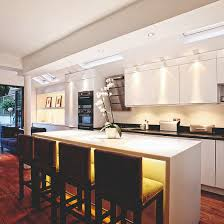 kitchen ceiling lighting design. kitchen with white cabinetry under cabinet lighting and yellow island bar lights ceiling design i