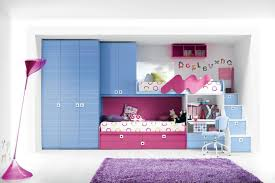 blue pink bunk bed connected with wardrobe and storage also drawers on the stairs plus desk bunk beds desk drawers