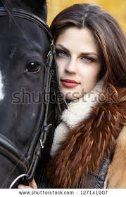 Portrait of a pretty young woman with a black horse riding autumn day - stock photo portrait of a pretty young. - stock-photo-portrait-of-a-pretty-young-woman-with-a-black-horse-riding-autumn-day-127141907