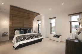 master bedroom feature wall: this contemporary master bedroom features a grey and stone palette with light timber feature wall white walls and splashes of black in decor give
