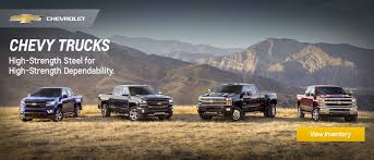 ron lewis chevrolet serving pittsburgh in beaver falls chevrolet truck lineup in a field