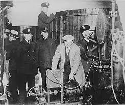american prohibition   argumentative essay prohibition  english detroit police inspecting equipment found in a clandestine underground brewery