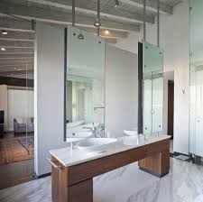 white mirrored bathroom wall cabinets: interesting modern bathroom wall cabinet sleek modern bathroom wall cabinet design with wooden vanities cabinet organizer white table top also small bar and spoon sink featuring twin large mirrors attached on vertical rod ideas modern bathro