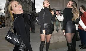 Miley Cyrus sizzles in <b>leather mini</b> skirt and <b>sexy</b> thigh-high boots in ...