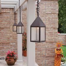 gallery outdoor kitchen lighting: carriagea lanterns provide outdoor kitchen light