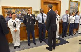u s department of defense photo essay president barack obama greets awaiting service members and offers them the presidential coin at the pentagon