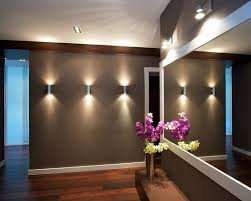 track lighting they are positioned in a straight line across the wall used for accent lighting you could use it as general lighting to give you any sort basement track lighting