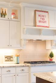 stand kitchen dsc: ive always had pantry items on display in the upper cabinets but thought it would be fun to switch them out with some christmas items like this