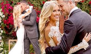 Christina El Moussa is a beautiful bride in white lace as she kisses ...
