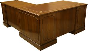 example of one of our bespoke l shaped desks with multiple brass cable inserts in dark oak bespoke office desks