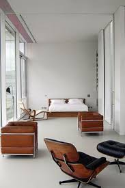 fantastic bedroom interior design completed with iconic eames chair furniture brown leather armchairs and clean glass door home furniture eames lounge bedroomterrific eames inspired tan brown leather short
