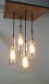 wine bottle chandelier with edison bulbs by rehabstyle i want this in my living room chandelier barn board