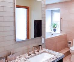 subway tiles tile site largest selection: were obsessed with the combination of neutral large format tiles long subway tiles and striking cookies n cream granite in this spa inspired bathroom