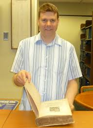 an interview dan paterson preservation specialist rare book dan holding a late medieval text from the law library s rare book collection which he treated