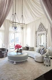 room fabio black modern: bullard draped sheer fabric of his own design to create volume and dimension in khloacs ornate living room which evokes a sumptuous take on a bedouin tent