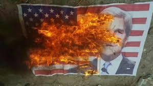 Image result for مردم آمریکا پرچم این کشور و اسرائیل را به آتش کشیدند