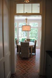 regina andrew lighting kitchen traditional with breakfast table brick floor image by house dressing interiors llc breakfast table lighting