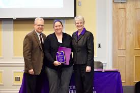 wcu heroes of first year student experience recognized honored fye faculty advocate award winner tara peterson center is congratulated by david starnes