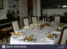 flower arrangements dining room table: stock photo dining room table set for christmas dinner with pohutukawa flower arrangement festive setting in a private home new zealand