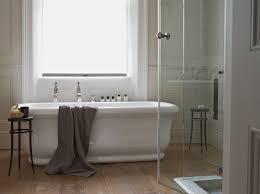 traditional bathroom lighting ideas bathroom traditional with wooden flooring freestanding bath white bath bathroom lighting ideas bathroom traditional