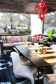 bright chandelier hung from colorful deck from kristin of the hunted interior bright ideas deck