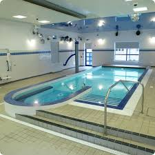 swimming poolfascinating indoor swimming pool design with artistic blue ceramic inside plus cream lounge amazing indoor pool lighting