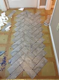 kitchen floor laminate tiles images picture: herringbone vinyl tile pattern via grace gumption