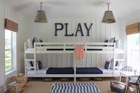 bunk room example of a large coastal gender neutral kids room design in jacksonville with white bunk bed bedroom sets kids
