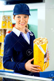 beautiful worker holding popcorn at cinema concession counter gallery of concession stand worker
