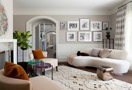 casual living room ideas with armless white sofa white patterned rug wood floors frames amazing interior casual living room