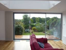 large sliding patio doors: fully stacked back onto the left hand wall adjacent to the patio doors