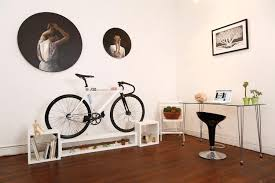 this furniture doubles as beautiful bike storage for tiny apartments coexist ideas impact apartment storage furniture