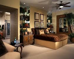 big master bedrooms couch bedroom fireplace: ornately decorated bedroom with wall art plants pillows and custom wood furniture
