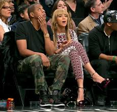 entertainers beyonce and jay z watch the brooklyn nets play the toronto raptors in the beyonce baby nursery