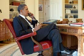 president barack obama talks on the phone jan 15 2010 pete souza barak obama oval office golds