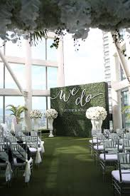 best ideas about wedding wall reception we do green ceremony backdrop and faux grass wedding aisle five questions