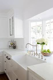images kitchen pinterest countertops cabinets a gorgeous farmhouse sink is paired with an antique polished nickel fa