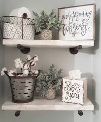 half bath decor: sharing my diy bathroom shelves for some fun monday tags we used plumbing pipes from menards for the hardware love how they turned out