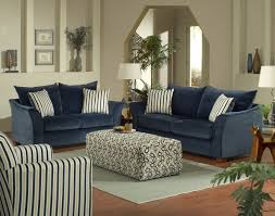 contemporary beige living room with blue couch also striped pillows plus white table lamps blue couch living room ideas