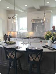 love the gray island with the white cabinets and the light fixture aqua shard subdued lighting