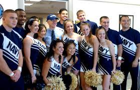 u s department of defense photo essay deputy defense secretary gordon england a former navy secretary poses navy cheerleaders who