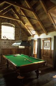 splashy billiard lights in family room traditional with pool cue rack next to billiard room alongside pool table lighting and bonus room billiard room lighting