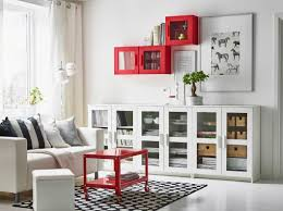storage solutions living room: living room designed with a fireplace and built in shelves for storage