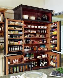 kitchen solution traditional closet: multi functional kitchen pantry storage in an elegant black armoire